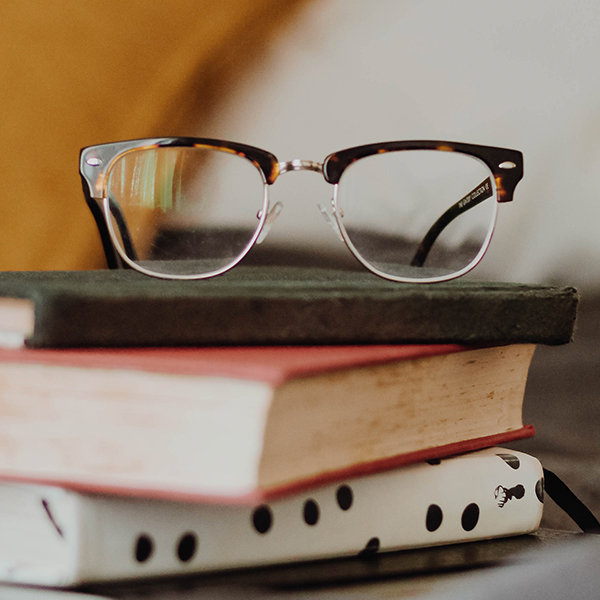 eye glasses on stack of books